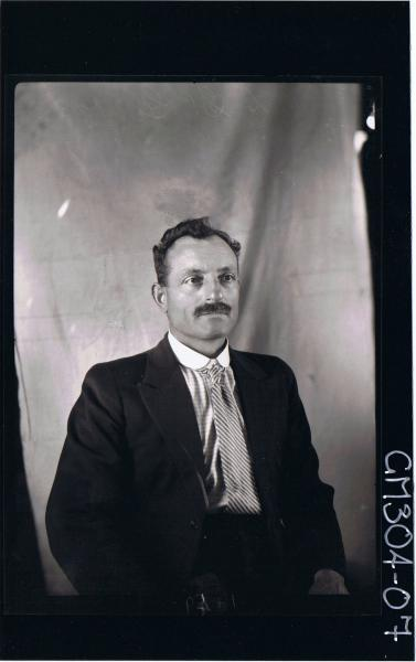 H/S Portrait of man wearing suit; 'St.George.L.'