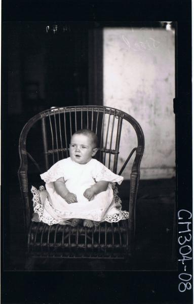 F/L Portrait of baby seated on chair wearing lace dress; 'Steel'