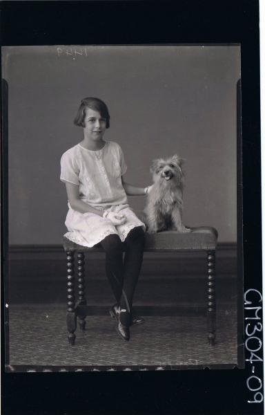 F/L Portrait of girl seated, wearing knee length lace dress & gloves, dog seated by her; 'Rossell'