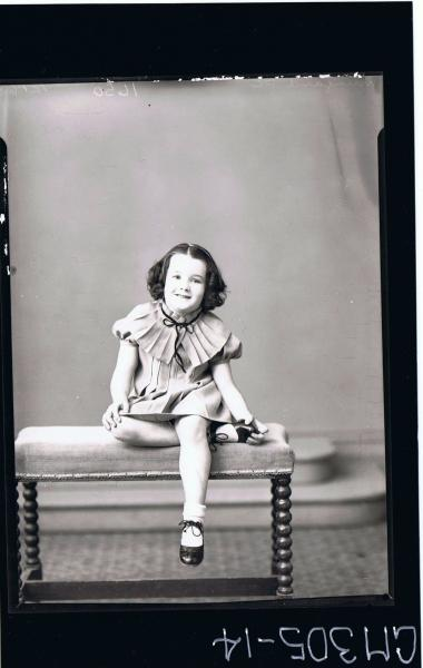 F/L Portrait of girl seated, wearing short dress with pleats and pleated collar; 'Mun?ard P. C.'