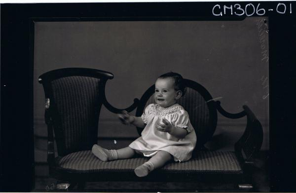 F/L Portrait of baby seated, wearing short dress; 'Marelich'
