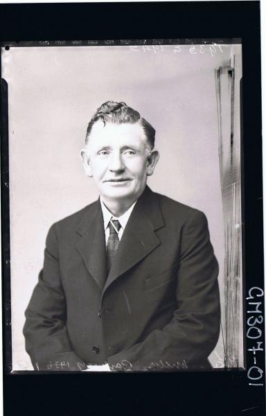 1/2 Portrait of elderly man wearing shirt, tie, jacket, Miller Railway, 1935. E. 1945