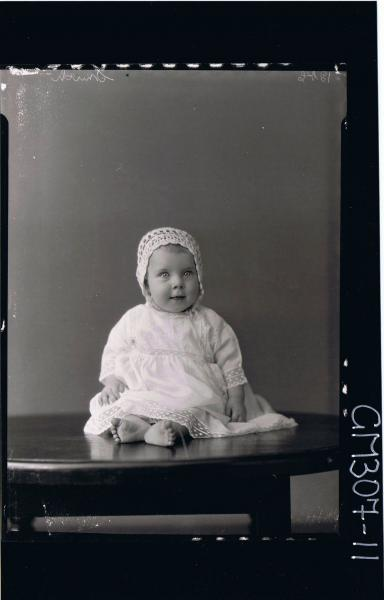 F/L Portrait of baby seated on table wearing a long lace dress and bonnet; 'Smith'
