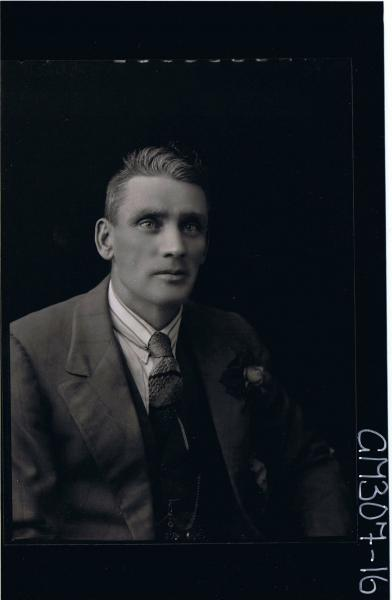 1/2 Portrait of man wearing three piece suit with rose on jacket; 'Skelt'