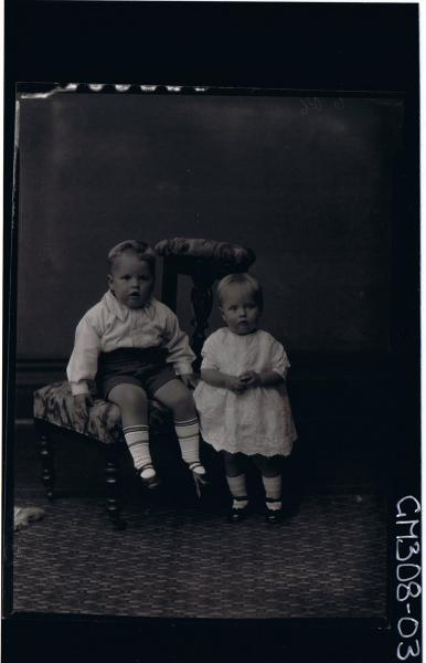 F/L Portrait of boy child, seated wearing shorts, shirt, girl child standing, wearing short lace dress; 'Smith'