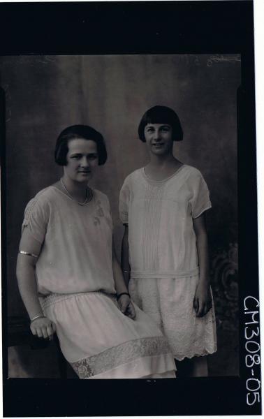 3/4 Portrait of woman seated, wearing lace dress, teenage girl standing, wearing knee length lace dress; 'Sansum'