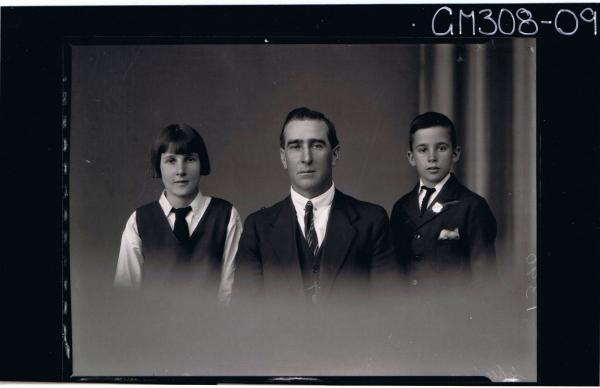 H/S Group Portrait of man in a suit,teenage girl wearing school uniform, boy wearing shirt,blazer with badge; 'Sheehan'