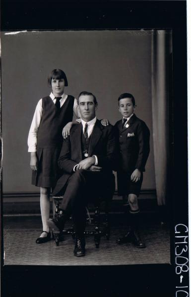 F/L Group portrait, man seated wearing 3 piece suit, teenage girl & boy standing both wearing school uniform; 'Sheehan'