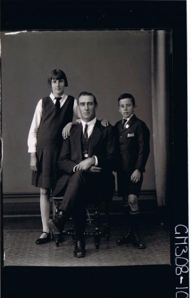 F/L Group portrait, man seated wearing 3 piece suit, teenage girl & boy standing both wearing school uniform; 'Sheehan'