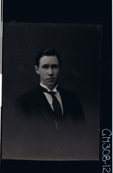 H/S Portrait of man wearing shirt, tie, jacket; 'Sholl'