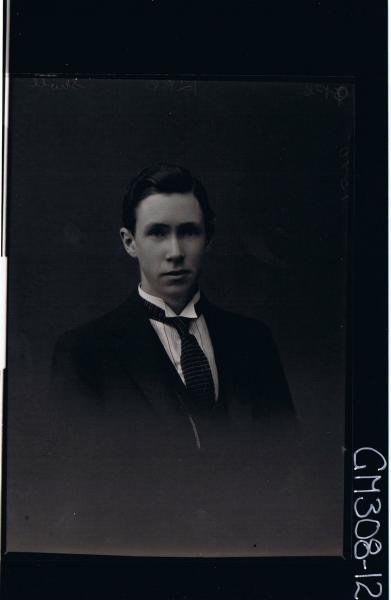 H/S Portrait of man wearing shirt, tie, jacket; 'Sholl'