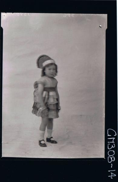 F/L Portrait of small girl standing wearing fancy dress costume; 'Suckcliffe'
