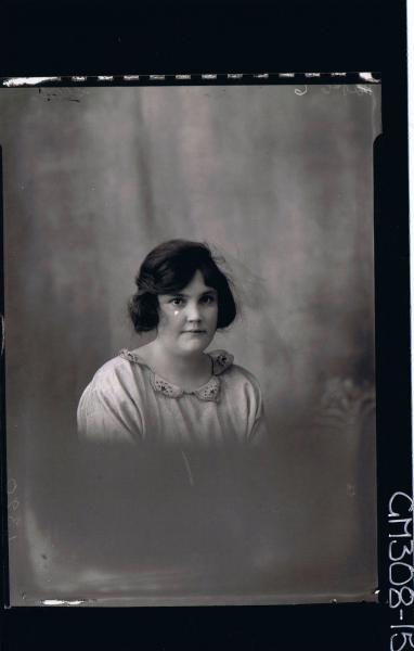 H/S Portrait of woman wearing day dress; 'Short'