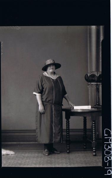 F/L Portrait of elderly lady standing, wearing three quarter length dress, hat; 'Stevens'