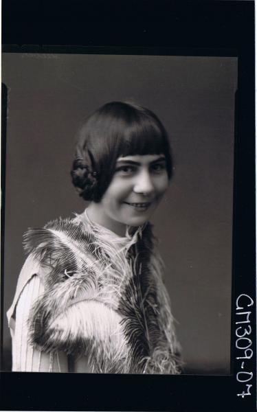 H/S Portrait of teenage girl holding large  feathers; 'Seeber' (side view)