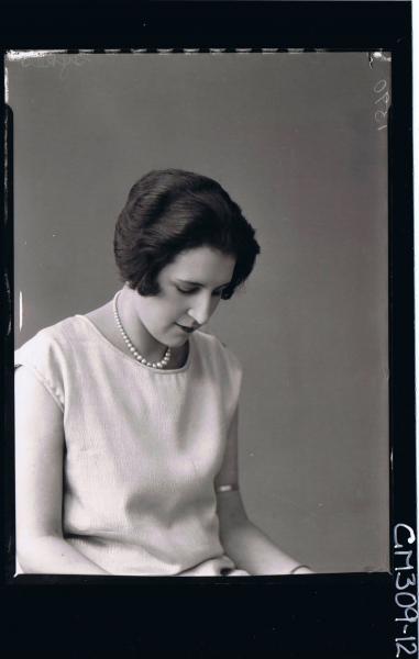 1/2 Portrait of woman wearing pearls; 'Sykes'