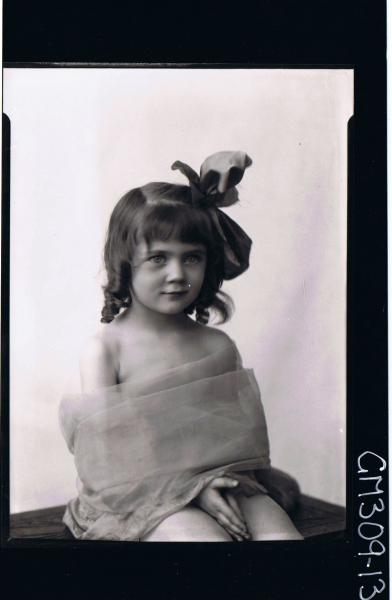 1/2 Portrait of girl seated, wearing material wrapped around body, ribbon in hair; 'Smith'