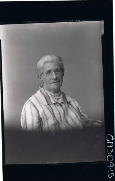 H/S Portrait of elderly lady wearing spectacles; 'North'