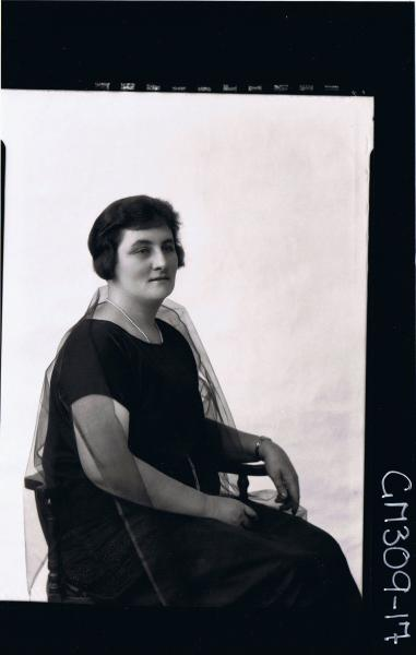 1/2 Portrait of woman seated, wearing stole around shoulders;'Matheson'