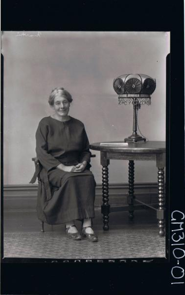 F/L Portrait of elderly woman seated, wearing a long dress; 'Martin'