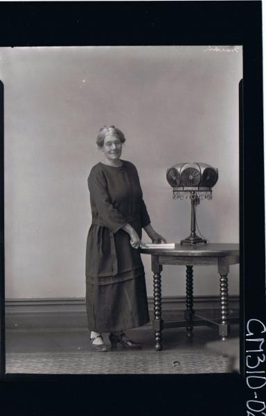 F/L Portrait of elderly woman standing wearing a long dress; 'Martin'