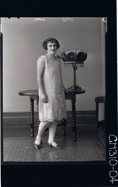 F/L Portrait of woman standing wearing knee length dress; 'Martin'