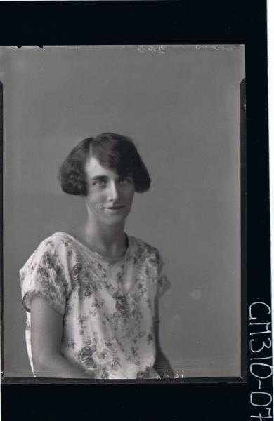 H/S Portrait of woman wearing floral day dress; 'Morris'