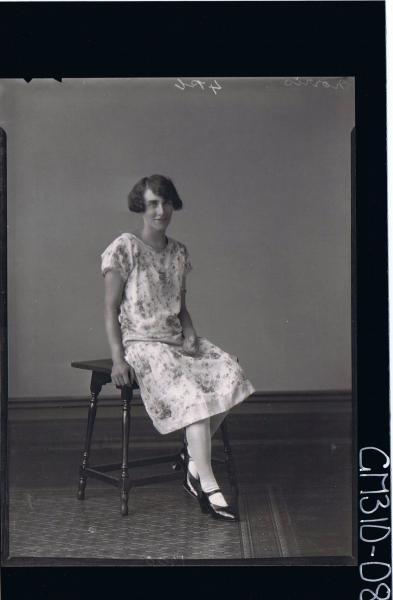 F/L Portrait of woman wearing floral day dress; 'Morris'