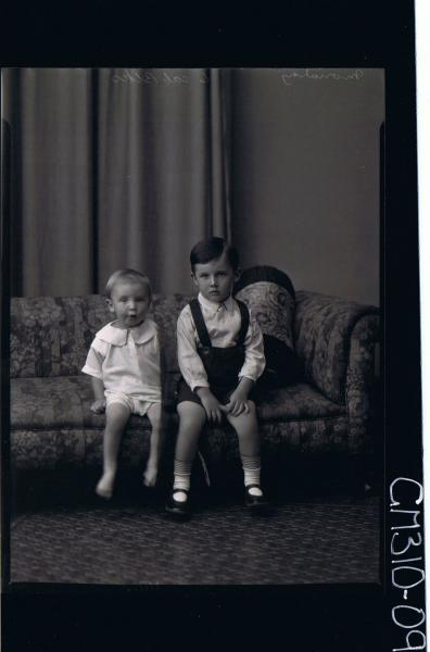 F/L Portrait of boy seated wearing shorts, shirt, child seated wearing pilchers, shirt, 'Moriarty'