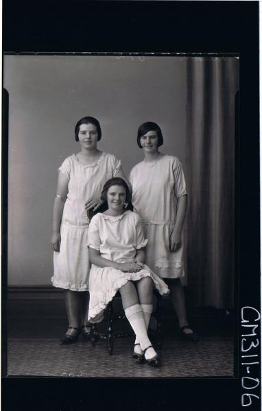 F/L Group portrait, three women, some standing some seated wearing knee length dresses; 'Neilson'