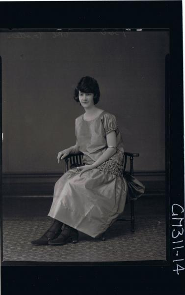 F/L Portrait of woman seated wearing ankle length satin dress 'Trotter'