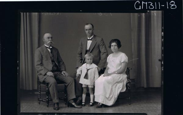F/L Group Portrait of elderly man, and young man seated, woman seated,small boy standing wearing shirt, shorts 'Sanders'