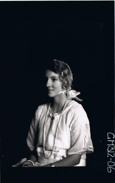 1/2 Portrait of woman seated wearing string of pearls, ribbon in hair 'Winter'