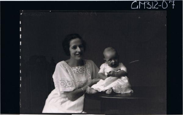 1/2 Portrait of woman seated, wearing lace dress, and F/L of baby seated on table wearing long lace dress 'Stewart'