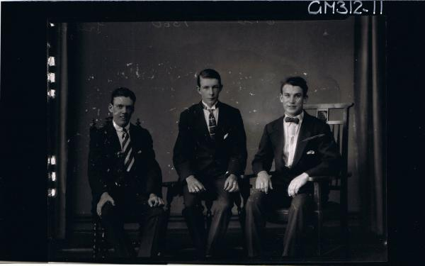 3/4 Portrait of 3 young men seated wearing suits, one man wearing bow tie 'Treloar'