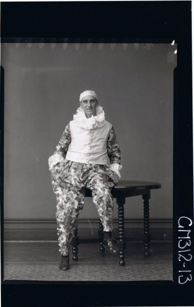 F/L Portrait of man seated wearing fancy dress clown costume 'Slee'