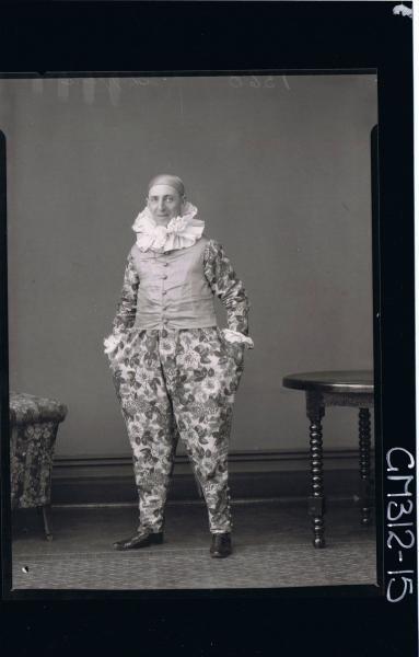F/L Portrait of man standing, wearing clown fancy dress costume 'Shepperd'