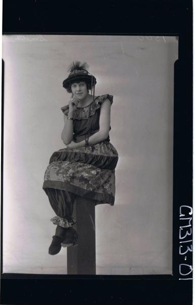F/L Portrait of woman seated on pillar wearing fancy dress costume 'Smith'