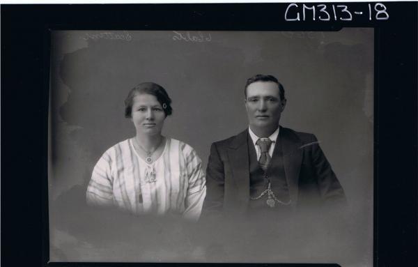 1/2 Portrait of man wearing three piece suit, woman wearing striped day dress 'Scattini'