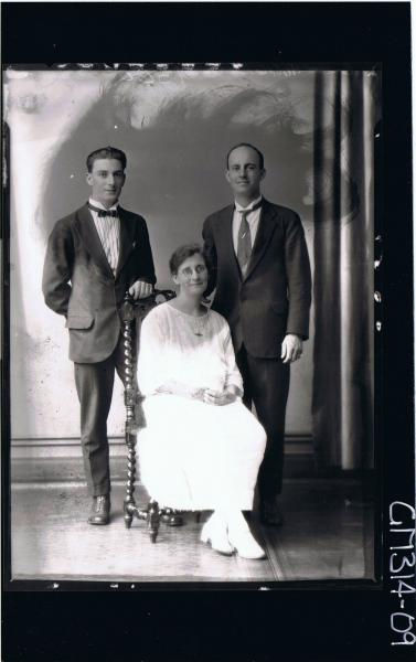 F/L Portrait of two men standing wearing suits, woman seated wearing ankle length lace dress, spectacles 'Taylor'