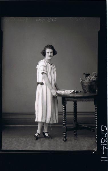 F/L Portrait of woman standing wearing three quarter length striped day dress 'Trantrum'