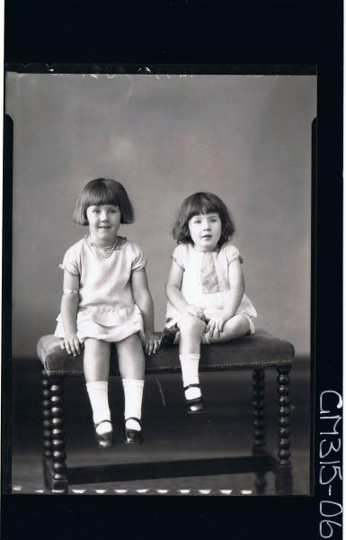 F/L Portrait of two girls seated wearing short dresses 'Mathews'