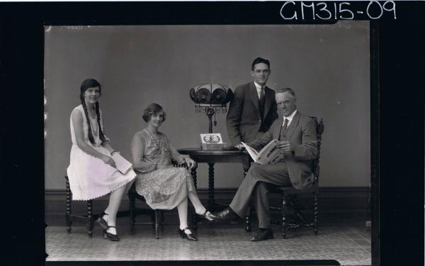 F/L Family Portrait of man seated wearing 3 piece suit,holding a book, 2 women seated, young man seated on table'Murray'