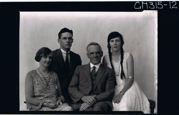 1/2 Portrait of man seated, wearing three piece suit, woman seated, wearing patterned dress, young man seated 'Murray'