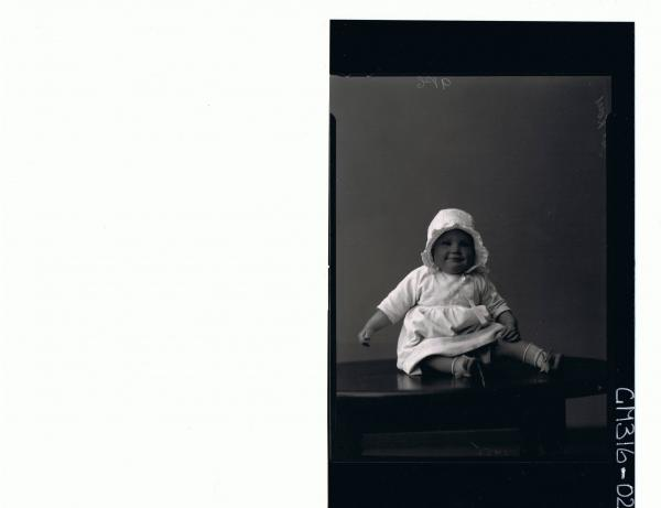 F/L Portrait of baby seated on table wearing dress, satin bonnet 'McKay'