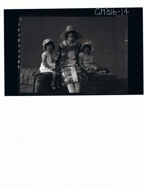 3/4 Portrait of woman seated, wearing knee length patterned dress,hat,2 girl children seated with short dresses'Mathews'
