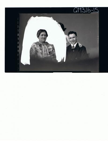 1/2 Group Portrait of woman,young man,girl,girl obscured by shading on the negative to highlight woman 'Miles'