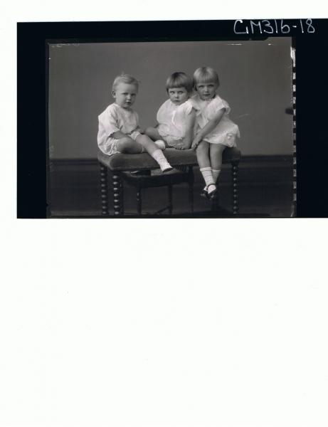 F/L Portrait of 3 children, 2 girls seated wearing short dresses, boy seated wearing one piece shorts & top 'Mulcahy'