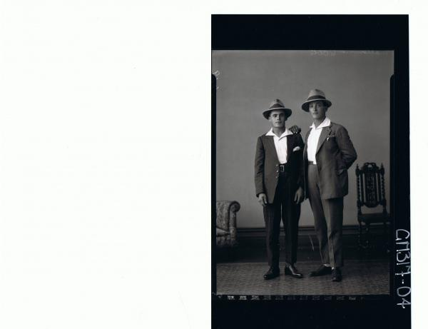 F/L Portrait of two men standing wearing suits and hats; 'Maccasini'