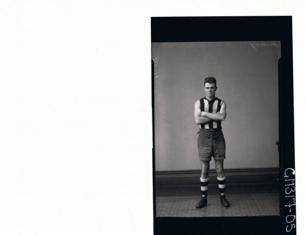 F/L Portrait of young man standing wearing shorts, football jumper and football socks; 'Murray'